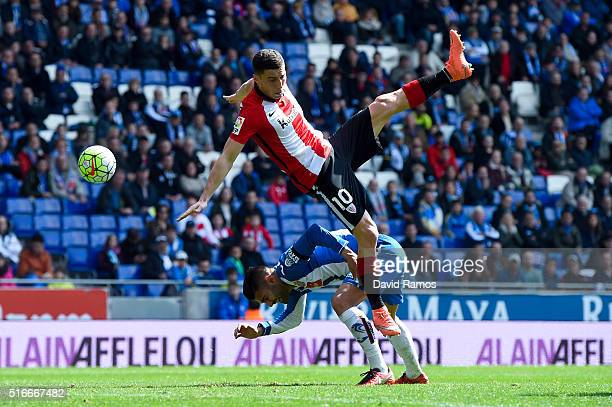 Oscar de Marcos of Athletic Club is brought down by Ruben Duarte of RCD Espanyol during the La Lga match between Real CD Espanyol and Athletic Club...