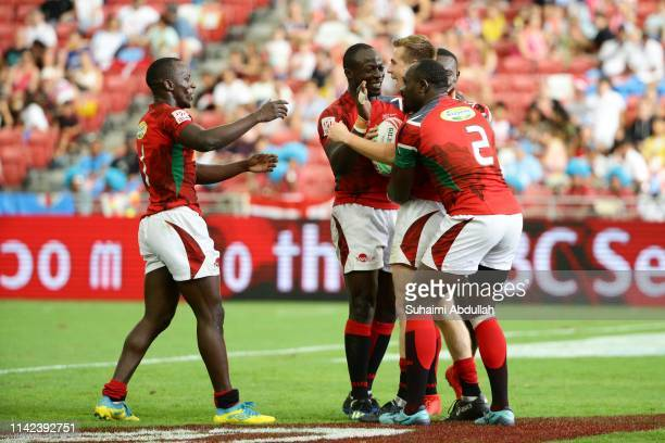 Oscar Dennis of Kenya celebrates scoring a try with his team mates during the Pool C match between Kenya and Wales on day one of the HSBC Rugby...
