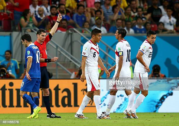 Oscar Duarte f Costa Rica walks off the pitch after being shown a red card off by referee Benjamin Williams during the 2014 FIFA World Cup Brazil...