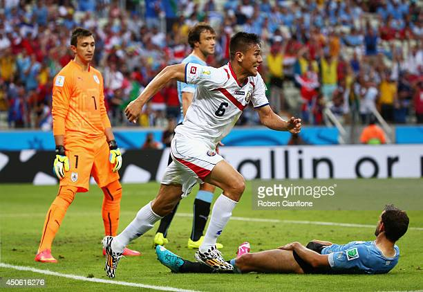 Oscar Duarte of Costa Rica celebrates after scoring his team's second goal past Fernando Muslera of Uruguay during the 2014 FIFA World Cup Brazil...