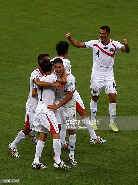 Oscar Duarte of Costa Rica celebrates scoring his team's second goal with teammates during the 2014 FIFA World Cup Brazil Group D match between...