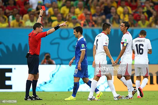Oscar Duarte of Costa Rica is shown a red card after his second bookable offense by referee Benjamin Williams during the 2014 FIFA World Cup Brazil...