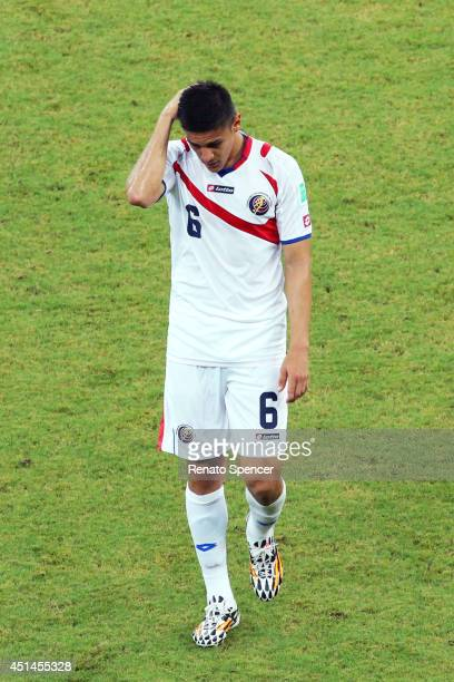 Oscar Duarte of Costa Rica walks off the pitch after receiving a red card from referee Benjamin Williams during the 2014 FIFA World Cup Brazil Round...