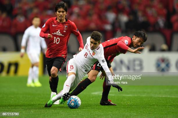 Oscar Emboaba Junior of Shanghai SIPG and Yuki Abe of Urawa Red Diamonds compete for the ball during the AFC Champions League Group F match between...