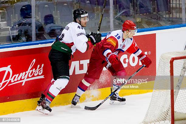 Oscar Engsund of Frolunda Gotenburg presses Pavel Razvadovsky of Yunost Minsk during the 3rd period of Champions Hockey League Round of 32 match...