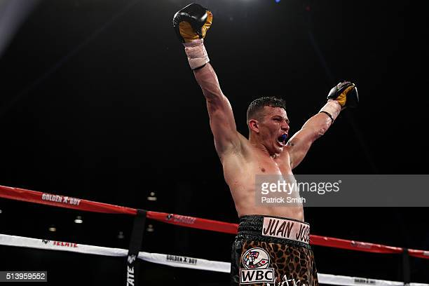 Oscar Escandon celebrates after defeating Robinson Castellanos in their WBC interim featherweight title match at the DC Armory on March 5, 2016 in...