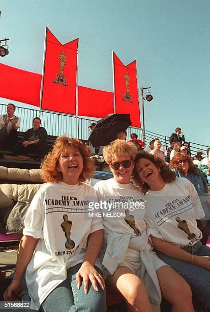 Oscar fans Jan Wood Connie Kleiner and Eva Staples sit on the bleachers 26 March in Los Angeles securing their seats for the arrival of movie stars...