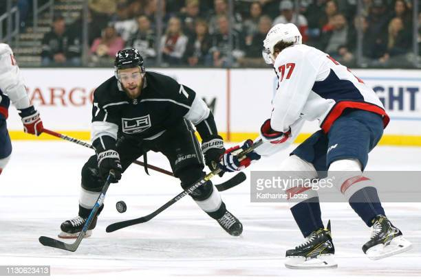 Oscar Fantenberg of the Los Angeles Kings and TJ Oshie of the Washington Capitals fight for control of the puck during the second period at Staples...