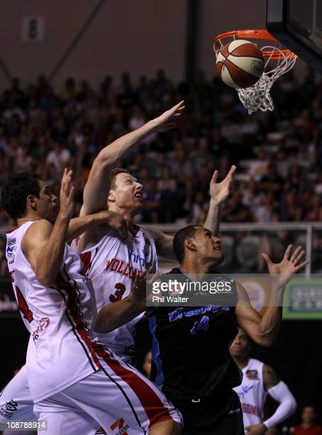 Oscar Forman and Tim Behrendorff of the Hawkes and Mika Vukona of the Breakers compete for the ball during the round 17 NBL match between the New...