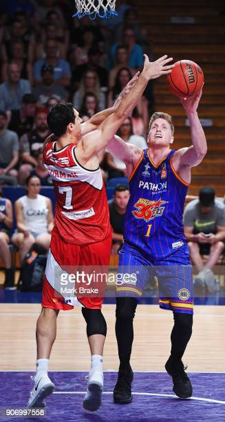 Oscar Forman of the Illawarra Hawks and Matthew Hodgson of the Adelaide 36ers during the round 15 NBL match between the Adelaide 36ers and the...