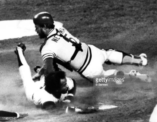 Oscar Gamble of the New York Yankees slides safely under the tag by Jeff Newman of the Oakland Athletics on October 13 1981 at Yankee Stadium in the...