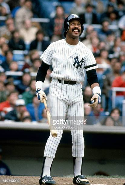 Oscar Gamble of the New York Yankees swings and watches the flight of his ball during a Major League Baseball game circa 1982 at Yankee Stadium in...