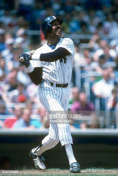Oscar Gamble of the New York Yankees swings and watches the flight of his ball during a Major League Baseball game circa 1983 at Yankee Stadium in...