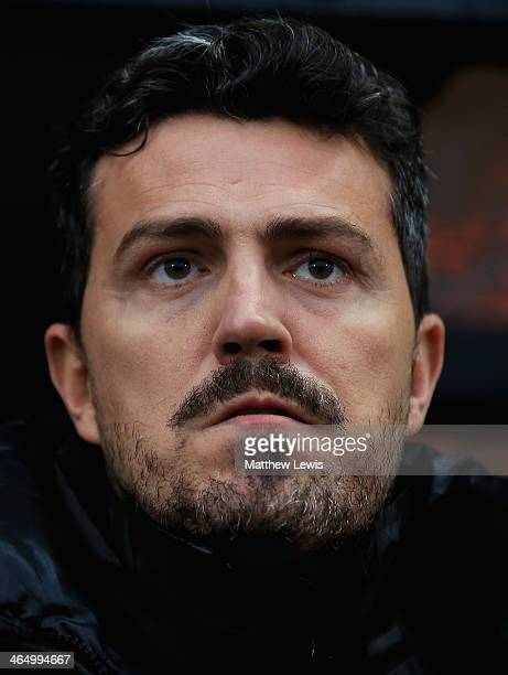 Oscar Garcia manager of Brighton Hove Albion looks on during the FA Cup fourth round match between Port Vale and Brighton Hove Albion at Vale Park on...