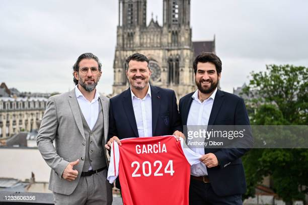 Oscar GARCIA New Head coach of Reims poses with his agents, Simone RANDANINI and Frederic RYSSEN during the press conference on June 23, 2021 in...