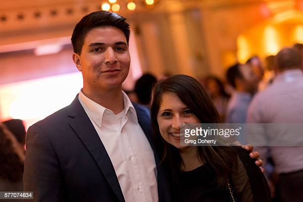 """Oscar Gonzales and Camille Totah pose for a picture at the 2016 Outfest Los Angeles Closing Night Gala Of """"Other People"""" After Party at The Theatre..."""