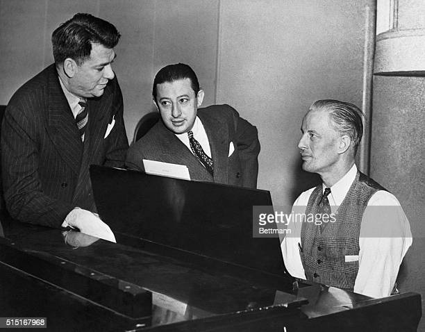 1/25/1941NY NY Oscar Hammerstein II Billy Rose and Russel Bennett script writer producer and conductor respectively are shown as they conferred at a...
