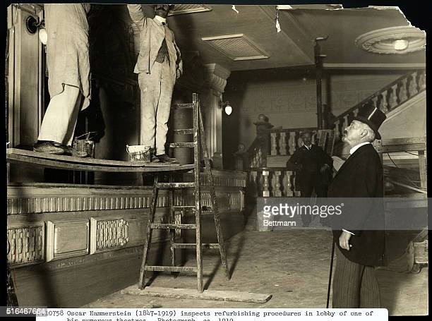 Oscar Hammerstein inspects the refurbishing procedures in the lobby of one of his numerous theaters Ca 1910