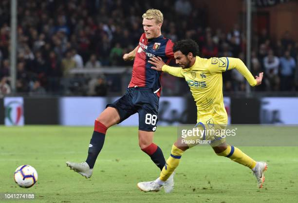 Oscar Hiljemark of Genoa battle for the ball with Mehdi Leris during the serie A match between Genoa CFC and Chievo Verona at Stadio Luigi Ferraris...