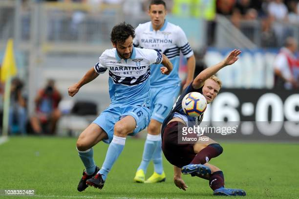 Oscar Hiljemark of Genoa CFC compete for the ball with Marco Parolo of SS Lazio during the serie A match between SS Lazio and Genoa CFC at Stadio...