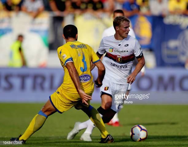 Oscar Hiljemark of Genoa CFC competes for the ball with Cristian Molinaro of Frosinone Calcio during the Serie A match between Frosinone Calcio and...