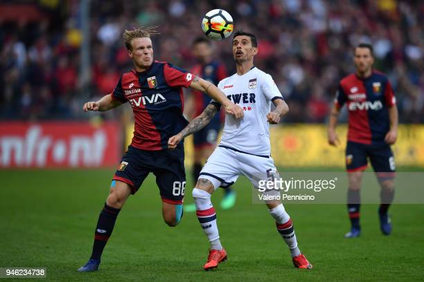 Oscar Hiljemark of Genoa CFC competes with Adrian Marius Stoian of FC Crotone during the serie A match between Genoa CFC and FC Crotone at Stadio...