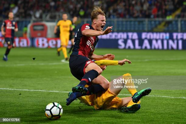 Oscar Hiljemark of Genoa CFC is tackled by Mattia Valoti of Hellas Verona FC during the Serie A match between Genoa CFC and Hellas Verona FC at...