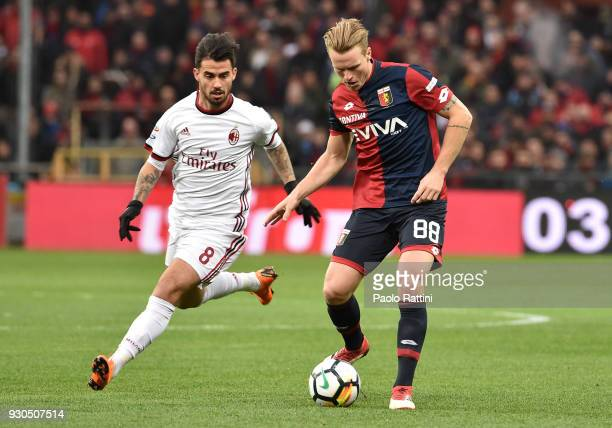 Oscar Hiljemark of Genoa opposed to Fernandez Suso of Milan during the serie A match between Genoa CFC and AC Milan at Stadio Luigi Ferraris on March...