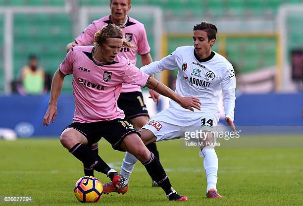 Oscar Hiljemark of Palermo holds off the challange from Juri Cisotti of Spezia during the TIM Cup A match betweenUS Citta di Palermo and AC Spezia at...