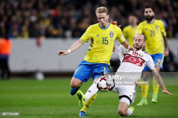 Oscar Hiljemark of Sweden and Ivan Maevski of Belarus compete for the ball during the FIFA 2018 World Cup Qualifier between Sweden and Belarus at...