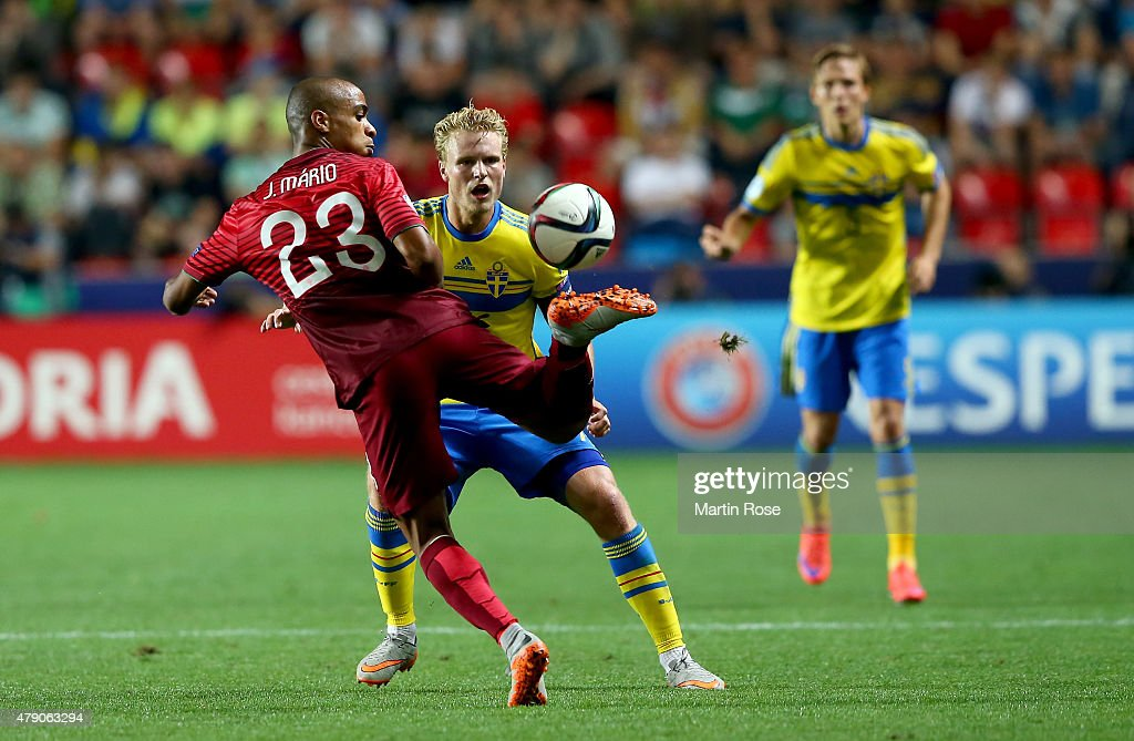 Oscar Hiljemark (R) of Sweden and Joao Mario of Portugal battle for the ball during the UEFA European Under-21 final match between Sweden and Portugal at Eden Stadium on June 30, 2015 in Prague, Czech Republic.