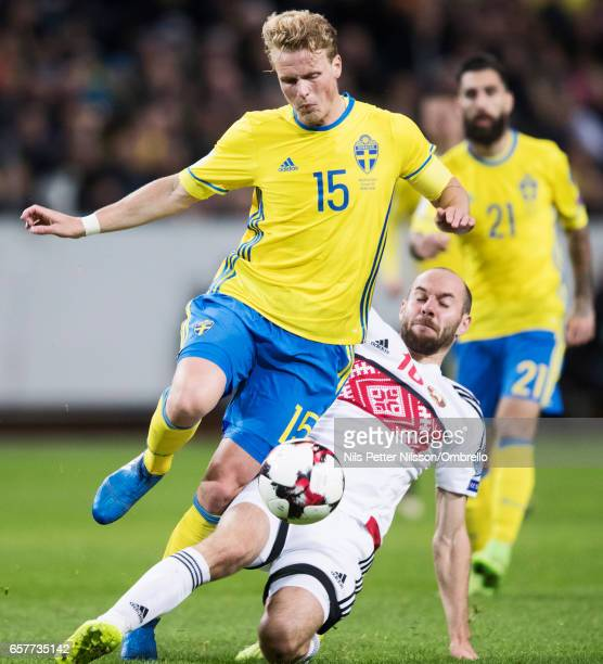 Oscar Hiljemark of Sweden and Renan Bressan of Belarus competes for the ball during the FIFA 2018 World Cup Qualifier between Sweden and Belarus at...