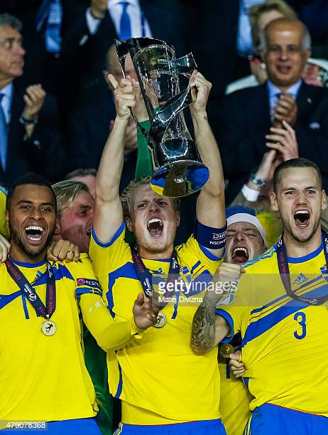 Oscar Hiljemark of Sweden lifts up trophy with his teammates after Swedish victory in UEFA U21 European Championship final match between Portugal and...