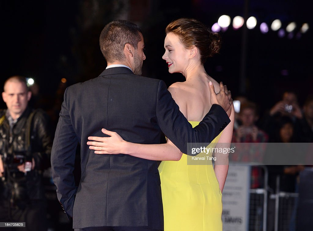 Oscar Isaac and Carey Mulligan attend the screening of 'Inside Llewyn Davis' Centrepiece Gala supported by the mayor of London during the 57th BFI London Film Festival at the Odeon Leicester Square on October 15, 2013 in London, England.