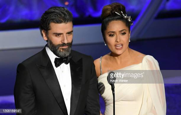 Oscar Isaac and Salma Hayek Pinault speak onstage during the 92nd Annual Academy Awards at Dolby Theatre on February 09 2020 in Hollywood California