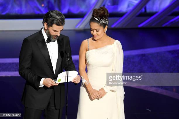 Oscar Isaac and Salma Hayek Pinault speak onstage during the 92nd Annual Academy Awards at Dolby Theatre on February 09, 2020 in Hollywood,...