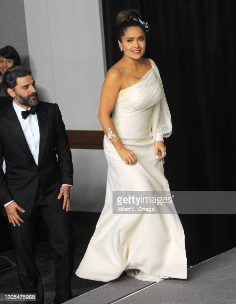 Oscar Isaac and Salma Hayek pose inside The Press Room of the 92nd Annual Academy Awards held at Hollywood and Highland on February 9, 2020 in...