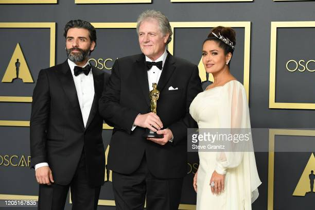 "Oscar Isaac, Donald Sylvester, winner of the Sound Editing award for ""Ford v Ferrari"" and Selma Hayek pose in the press room during the 92nd Annual..."