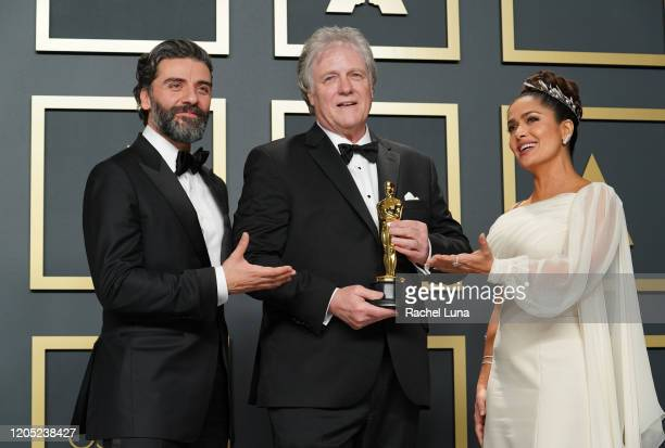 "Oscar Isaac, Donald Sylvester, winner of the Sound Editing award for ""Ford v Ferrari,"" and Salma Hayek pose in the press room during the 92nd Annual..."