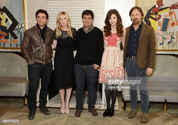 Oscar Isaac Kirsten Dunst Director Hossein Amini Daisy Bevan and Viggo Mortensen pose at a photocall for 'The Two Faces Of January' at Corinthia...