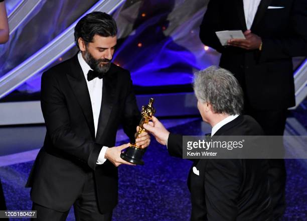 Oscar Isaac presents the Sound Editing award for 'Ford v Ferrari' to Donald Sylvester onstage during the 92nd Annual Academy Awards at Dolby Theatre...