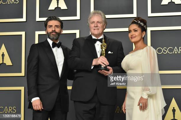 "Oscar Isaac, sound engineer Donald Sylvester, winner of the Sound Editing award for ""Ford v Ferrari,"" and Salma Hayek pose in the press room during..."