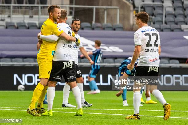 Oscar Jansson goalkeeper for Orebro SK celebrates their 2-1 victory with teammates Michael Almeback and Albin Granlund during an Allsvenskan match...