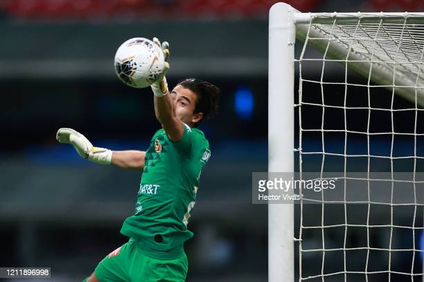 Oscar Jiménez of America makes a save during a quarter final first leg match between Club America and Atlanta United as part of CONCACAF Champions...