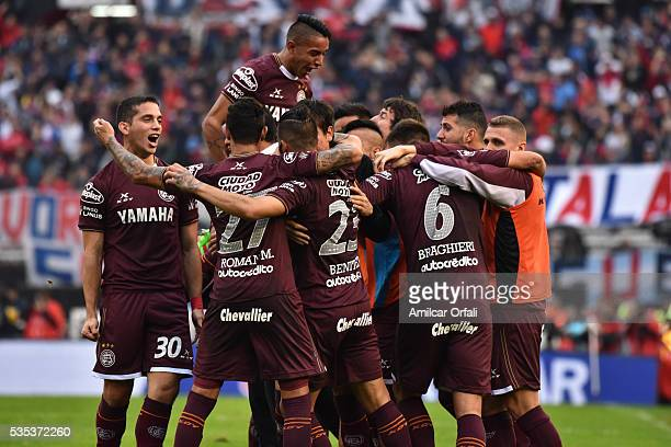 Oscar Junior Benitez of Lanus celebrates with teammates after scoring the opening goal during a final match between San Lorenzo and Lanus as part of...
