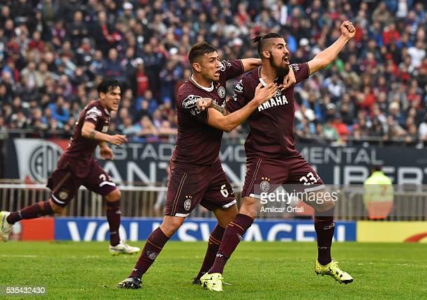 Oscar Junior Benitez of Lanus celebrates with teammates after scoring the opening goal during a final match between San Lorenzo and Lanus as part of...
