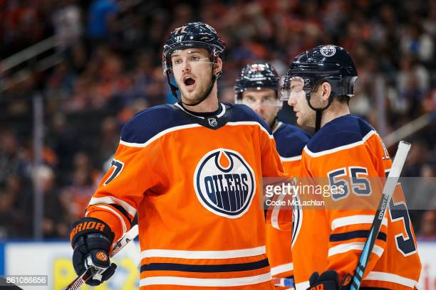 Oscar Klefbom and Mark Letestu of the Edmonton Oilers strategize against the Winnipeg Jets at Rogers Place on October 9 2017 in Edmonton Canada