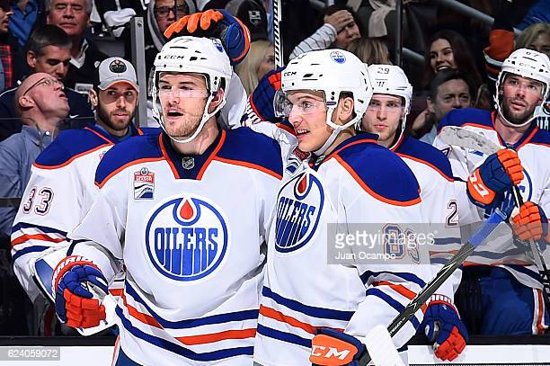 Oscar Klefbom and Matthew Benning of the Edmonton Oilers celebrate Klefbom's second period goal against the Los Angeles Kings on November 17 2016 at...