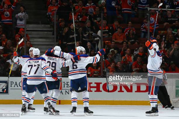 Oscar Klefbom Leon Draisaitl Adam Larsson and Patrick Maroon of the Edmonton Oilers celebrate a goal in the third period in Game One of the Western...