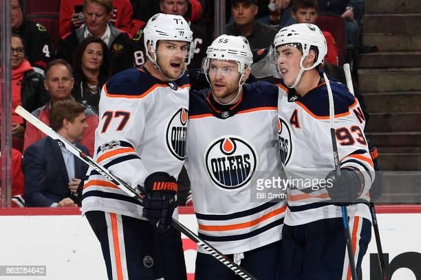 Oscar Klefbom Mark Letestu and Ryan NugentHopkins of the Edmonton Oilers celebrate after Letestu scored the game winning goal in overtime against the...